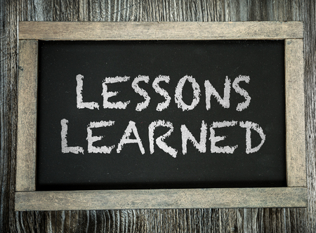learned: Lessons Learned written on chalkboard Stock Photo
