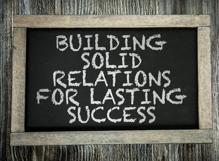 lasting: Building Solid Relations For Lasting Success written on chalkboard
