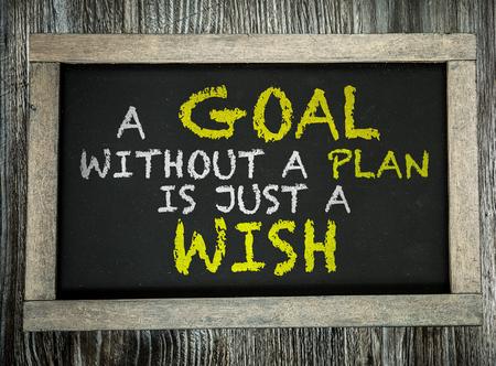Ein Ziel ohne einen Plan ist nur ein Wunsch geschrieben auf Tafel