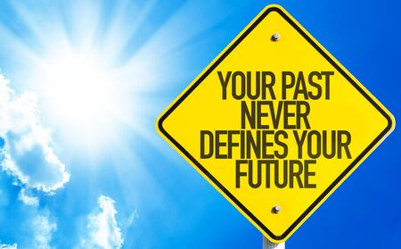 defines: Your Past Never Defines Your Future sign with sky background Stock Photo