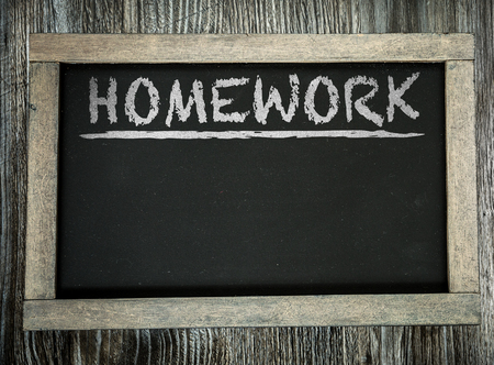 Homework written on chalkboard