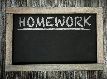 Homework written on chalkboard