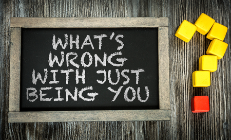 distinction: Whats Wrong With Just Being You written on a chalkboard