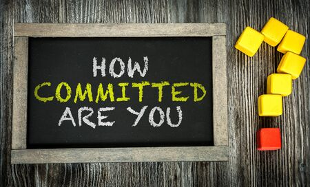 committed: How Committed Are You written on chalkboard Stock Photo