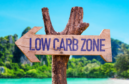 wellness: Low Carb Zone arrow with beach background Stock Photo