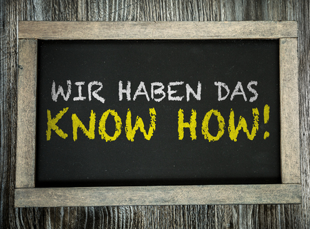 knowhow: Wir haben das, know how! (We have the know-how in German) written on blackboard