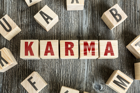 vibrations: Karma written on a wooden cube background