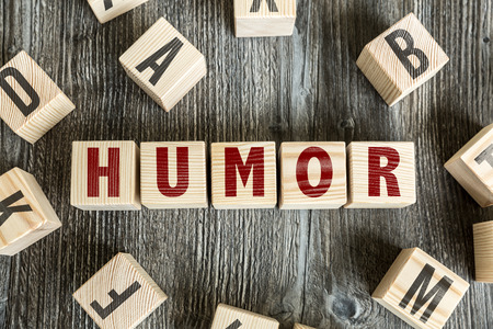 humor: Humor written on a wooden cube background Stock Photo