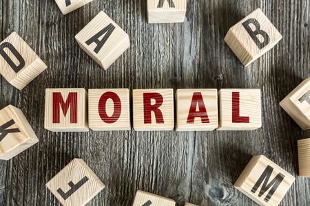 Moral written on a wooden cube background