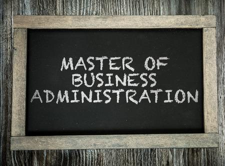 master: Master of business administration written on blackboard Stock Photo