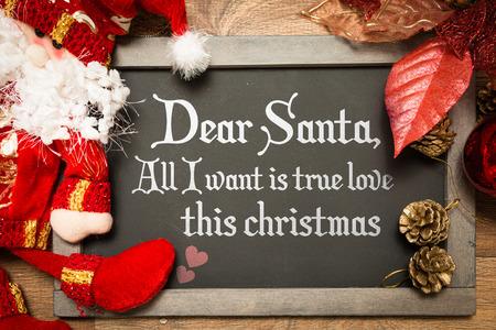 desires 25: Dear Santa, all I want is true love this Christmas written on blackboard