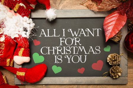 desires 25: All I want for Christmas is you written on blackboard