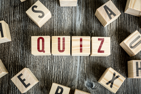 quizzing: Quiz written on a wooden cube background Stock Photo