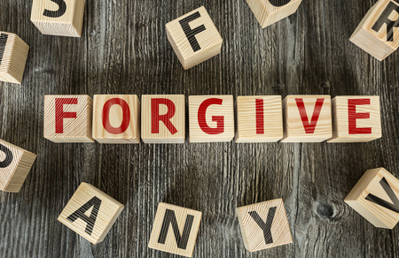 pardon: Forgive written on a wooden cube background