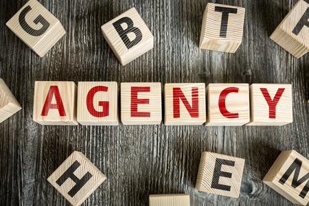 adwords: Agency written on a wooden cube background Stock Photo
