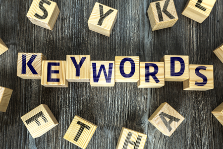 Keywords written on a wooden cube background