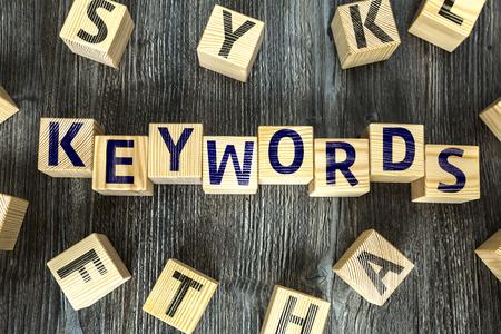 keywords background: Keywords written on a wooden cube background