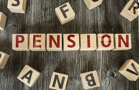 pension: Pension written on a wooden cube background
