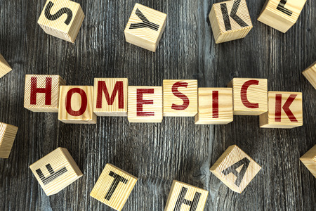 hankering: Homesick written on a wooden cube background