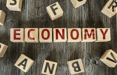 exportation: Economy written on a wooden cube background Stock Photo
