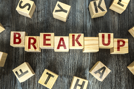 Break up written on a wooden cube background Archivio Fotografico