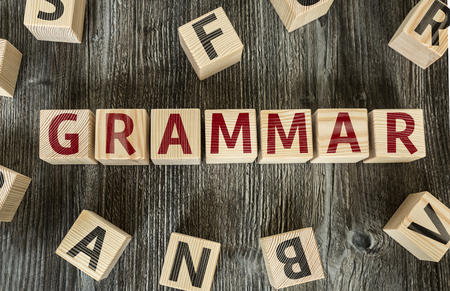 tense: Grammar written on a wooden cube background