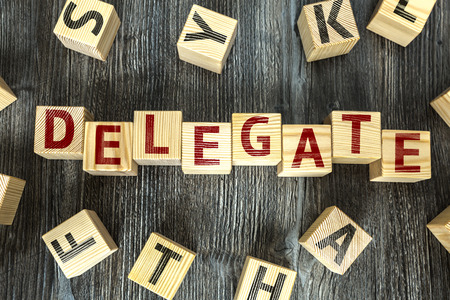 appoint: Delegate written on a wooden cube background