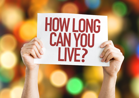 longevity medicine: Hands holding cardboard on bokeh background with text: How long can you live?