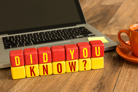 Did you know? written on a wooden cube with laptop background Stock Photo