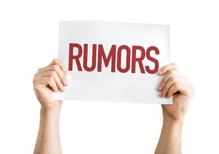 spread the word: Hands holding cardboard on white background with text: Rumors Stock Photo