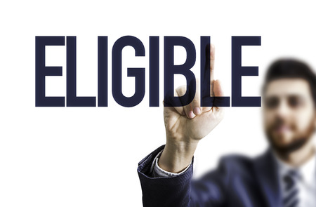 eligible: Business man pointing to transparent board with text: Eligible
