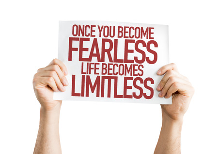 unafraid: Hands holding cardboard on white background with text: Once you become fearless life becomes limitless Stock Photo