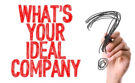 Handschrift op een witte achtergrond met tekst: Wat is uw ideale bedrijf? Stockfoto