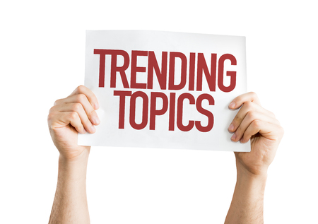 topics: Hands holding cardboard on white background with text: Trending topics