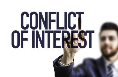 conflicting: Business man pointing to transparent board with text: Conflict of interest