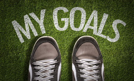 Text on field with shoes background: My goals Stock Photo