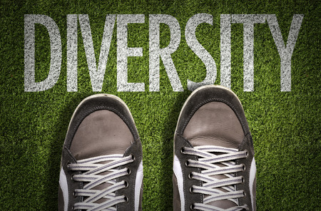 Text on field with shoes background: Diversity
