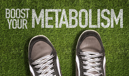 metabolic: Text on field with shoes background: Boost your metabolism Stock Photo
