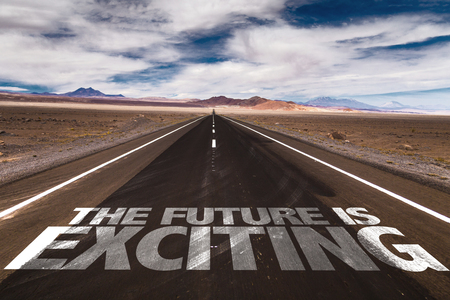 The future is exciting written on the road sign with clouds and sky background Foto de archivo