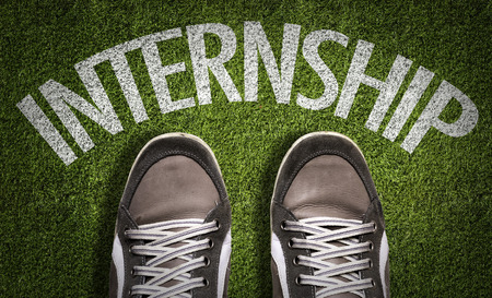 application university: Text on field with shoes background: Internship