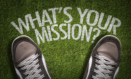 Text on field with shoes background: Whats your mission?