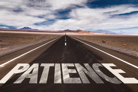 paciencia: La paciencia escrito en la señal de tráfico con las nubes y el cielo de fondo Foto de archivo