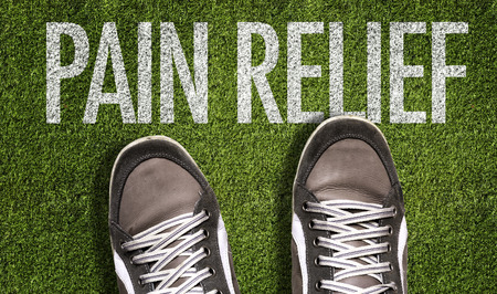 Text on field with shoes background: Pain relief