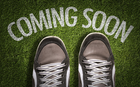 proclaim: Text on field with shoes background: Coming soon