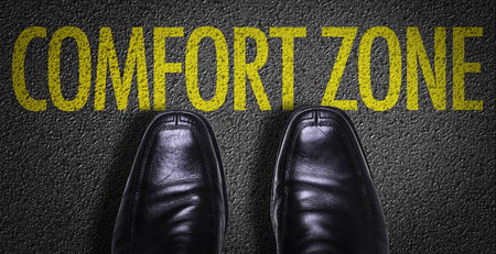 secure growth: Text on road with business shoes background: Comfort zone Stock Photo