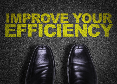 Text on road with business shoes background: Improve your efficiency