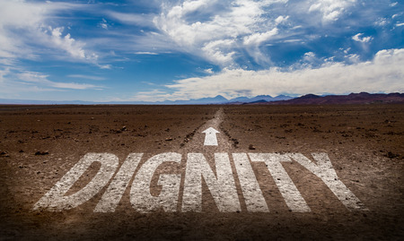 Dignity written on desert background