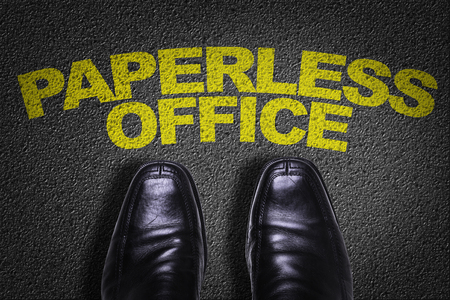 paperless: Text on road with business shoes background: Paperless office