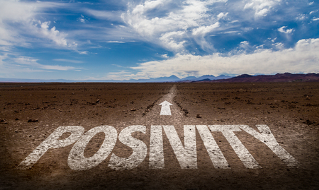 positivismo: Positivity written on desert background