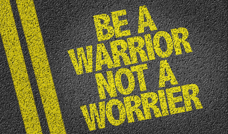 road warrior: Text on tar road: Be a warrior not a worrier